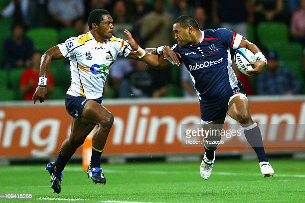 Cooper Vuna of the Rebels is tackled during the round two Super Rugby match between the Melbourne Rebels and the Brumbies at AAMI Park on February 25...