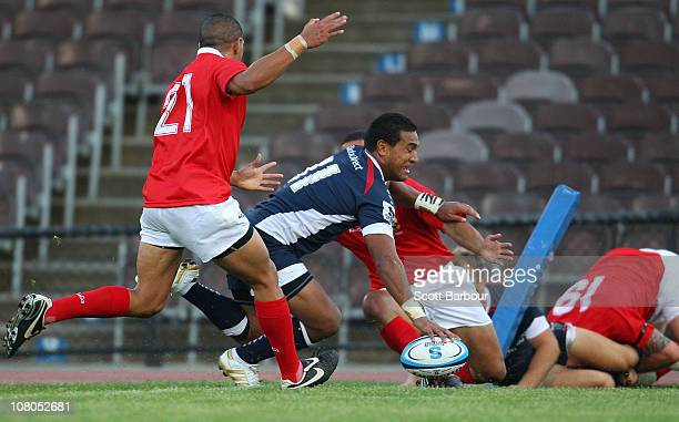 Cooper Vuna of the Rebels scores a try during the Super Rugby trial match between the Melbourne Rebels and Tonga at Olympic Park on January 15 2011...
