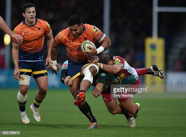 Cooper Vuna of Worcester Warriors is tackled by Jamie Roberts of Harlequins during the Aviva Premiership match between Worcester Warriors and...
