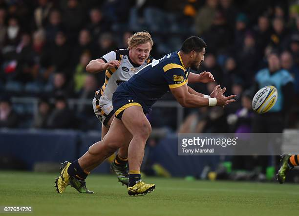 Cooper Vuna of Worcester Warriors is tackled by Tommy Taylor of Wasps during the Aviva Premiership match between Worcester Warriors and Wasps at...