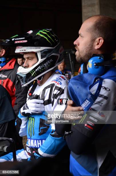 Cooper Webb 450SX Factory Yamaha and team mechanic place their hands over heart for singing of National Anthem at the Monster Energy AMA Supercross...