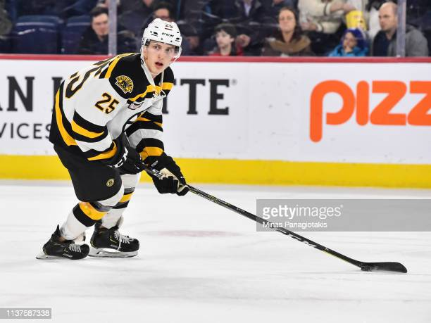Cooper Zech of the Providence Bruins skates the puck against the Laval Rocket during the AHL game at Place Bell on March 20 2019 in Laval Quebec...