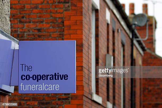 A CoOperative Funeralcare logo sits on a sign outside a funeral arrangement store operated by the CoOperative Group Ltd in High Lane UK on Thursday...