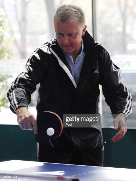 Coordination Commission Chairman Hein Verbruggen plays table tennis after the opening of the IOC Coordination Commission meeting at the Beijing...