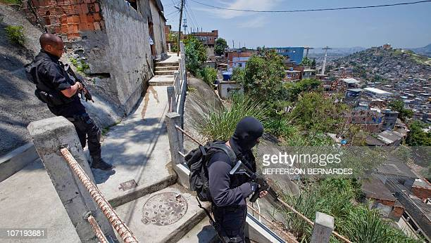 A Coordination of Special Resources policeme patrol in Morro do Alemao shantytown on November 29 2010 in Rio de Janeiro Brazil Police scoured the...