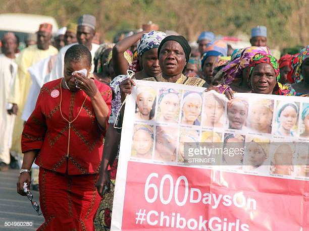 Coordinator of the 'Bring Back Our Girls' Nierian movement Oby Ezekwesili sobs as she lead mothers of missing Chibok schoolgirls holding a banner...