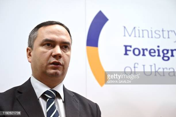 Coordinator of the Ukrainian Ministry of foreign affairs operational crisis group Maksym Kovalenko speaks to media during a briefing in Kiev on...