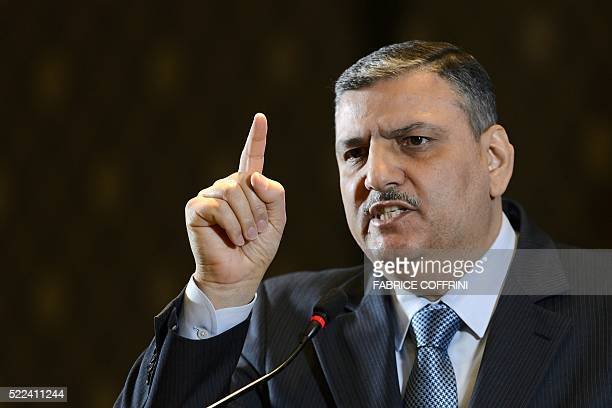 HNC coordinator Riad Hijab gestures during a press conference of the HCN in Geneva on April 19 2016 Syria's opposition has postponed its 'formal...