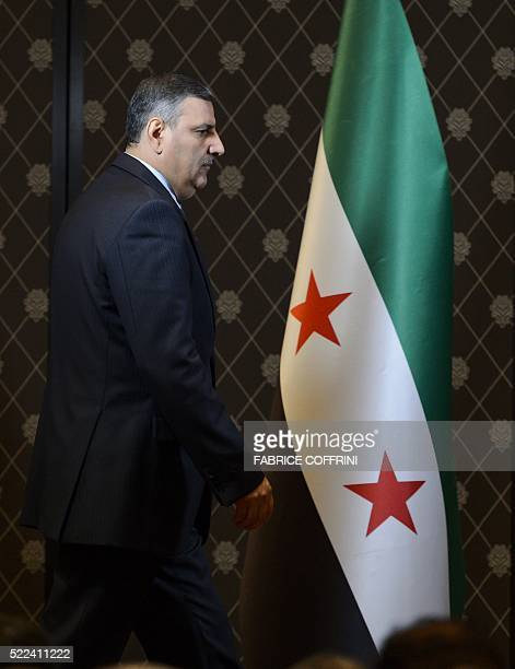 HNC coordinator Riad Hijab shows arrives to a press conference of the HCN in Geneva on April 19 2016 Syria's opposition has postponed its 'formal...