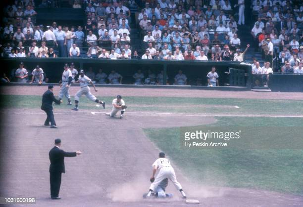 Coot Veal and Bobo Osborne of the Detroit Tigers complete the double play as George Strickland and Vic Power of the Cleveland Indians are out during...