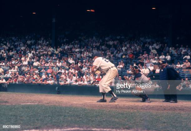 Coot Veal of the Detroit Tigers attempts to bunt during an MLB game against the Cleveland Indians on July 4 1959 at Briggs Stadium in Detroit...