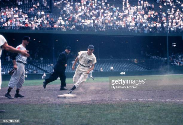 Coot Veal of the Detroit Tigers rounds third base during an MLB game against the Cleveland Indians on July 4 1959 at Briggs Stadium in Detroit...
