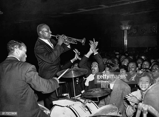 Cootie Williams plays his trumpet in a crowed Harlem ballroom with Duke Ellington's band in the 1930s With Ellington's band Williams found his...