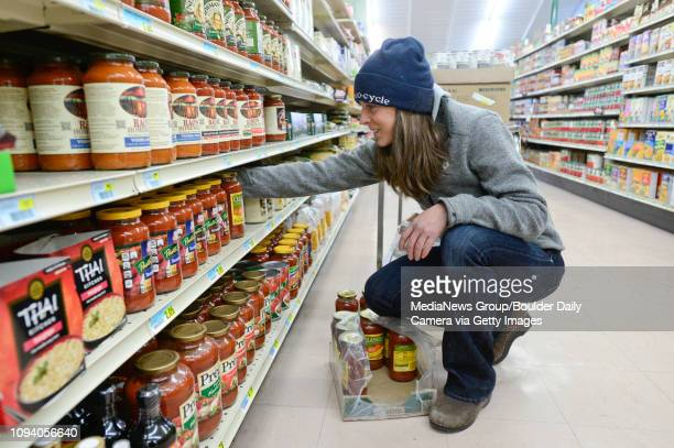 Coowner Alison Steele stocks shelves while wearing multiple layers of clothing and a hat to keep warm Friday Dec 6 at Niwot Market Xcel Energy is...
