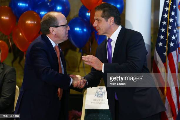 CoOwner and Alternative Governer of the New York Islanders Jon Ledecky and Governor of New York Andrew Cuomo shake hands during a press conference at...