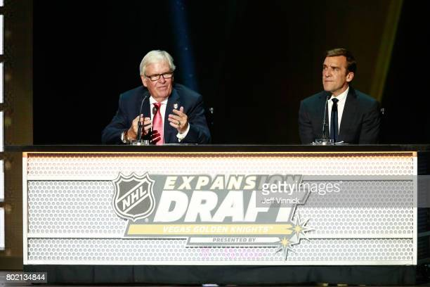 Coowner Bill Foley left and general manager George McPhee of the Vegas Golden Knights make another selection onstage during the 2017 NHL Awards...
