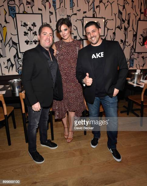 Coowner Chris Barish actress Katie Holmes and coowner Joe Isidori attend the grand opening of Black Tap Craft Burgers Beer at The Venetian Las Vegas...