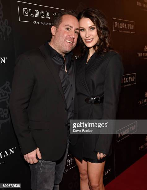 Coowner Chris Barish and and his wife Julie Mulligan attend the grand opening of Black Tap Craft Burgers Beer at The Venetian Las Vegas on December...