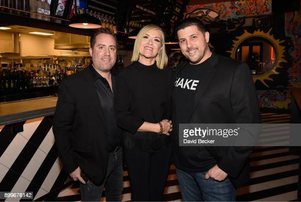 Coowner Chris Barish Lisa Long Adler and coowner Joe Isidori attend the grand opening of Black Tap Craft Burgers Beer at The Venetian Las Vegas on...