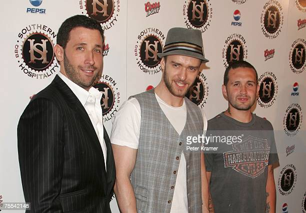 Coowner Eytan Sugarman singer Justin Timberlake and Coowner Trace Alaya attend the grand opening of their new restaraunt Southern Hospitality on July...
