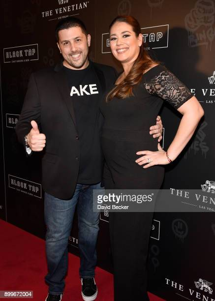 Coowner Joe Isidori and his wife Louise Isidori attend the grand opening of Black Tap Craft Burgers Beer at The Venetian Las Vegas on December 29...