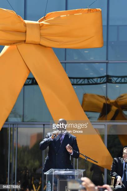 Coowner Magic Johnson of the Los Angeles FC speaks to fans and media at the ribbon cutting ceremony for the new Banc of California Stadium on April...