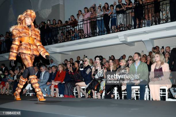 CoOwner of Gaultier Marc Puig a guest Catherine Deneuve Gilles Dufour a guest Miss Fame two guests Christina Aguilera Derek Blasberg and Amanda Lear...