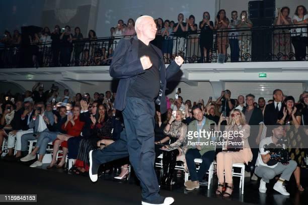 Co-Owner of Gaultier, Marc Puig, Catherine Deneuve, Gilles Dufour, Christina Aguilera, Derek Blasberg and Amanda Lear watching Designer Jean-Paul...