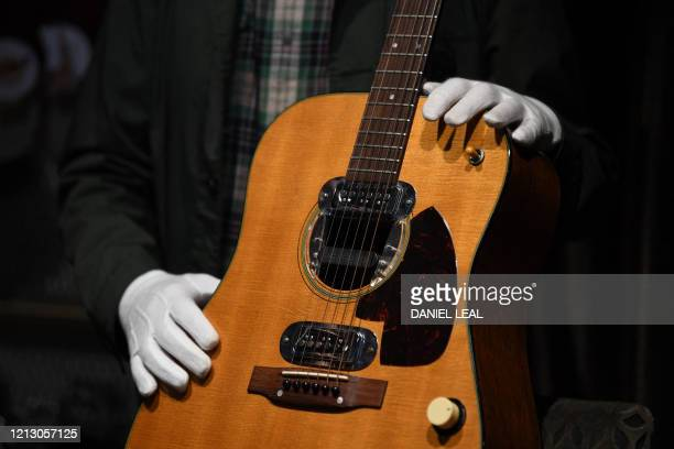 Co-owner of Julien's Auctions, Martin Nolan displays the guitar used by musician Kurt Cobain during Nirvana's famous MTV Unplugged in New York...