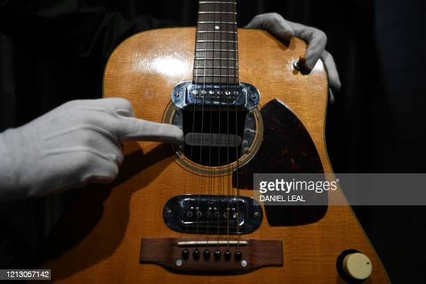 Coowner of Julien's Auctions Martin Nolan displays the guitar used by musician Kurt Cobain during Nirvana's famous MTV Unplugged in New York concert...