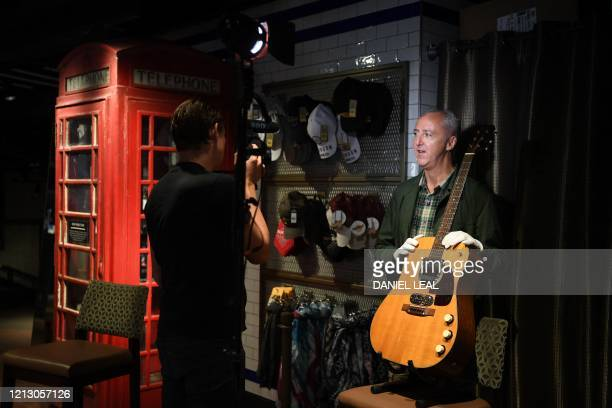 Coowner of Julien's Auctions Martin Nolan holds the guitar used by musician Kurt Cobain during Nirvana's famous MTV Unplugged in New York concert in...