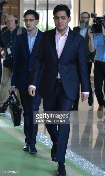 Coowner of team Mumbai Indians Akash Ambani arrives for the 2nd day of IPL 2018 Player Auction in Bangalore on January 28 2018 / AFP PHOTO /...