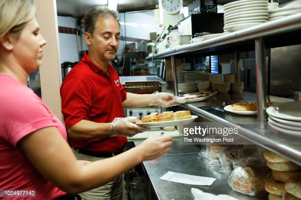August 26: Co-owner Tom Kouvatsos works in the kitchen at the Village Cafe on August 26, 2018 in Siesta Key, Florida. Florida Governor Rick Scott...