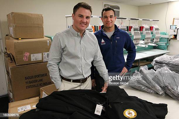 Coowners of Custom Universe and Sail Loft Company from left to right Peter Mugford and Robert Noe Jr blue sweater at company headquarters