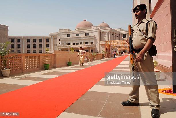 CRPF cop alert during an inaugural ceremony of new building of High Court on March 19 2016 in Lucknow India Speaking at the inauguration of the new...
