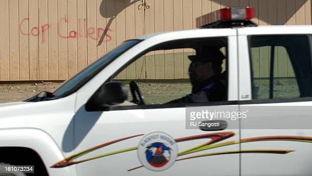 BROWNING MONTANA A cop drives past a house on the Blackfeet Reservation in Browning MO where people marked Cop Caller on the exterior of a home It's...