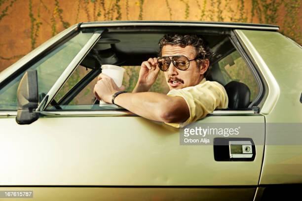cop in a car - kitsch stock pictures, royalty-free photos & images