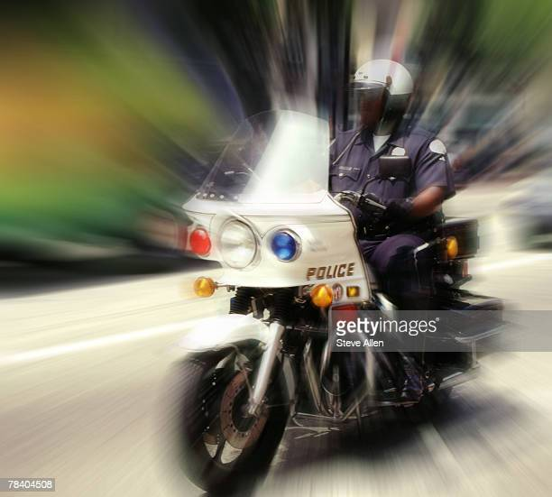 Cop riding motorcycle
