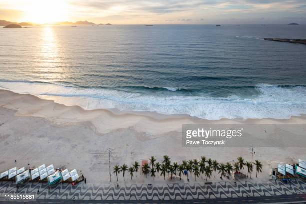 copacabana beach at sunrise in rio de janeiro, brazil - image stock pictures, royalty-free photos & images