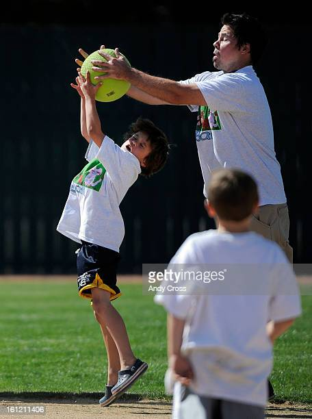 DENVER COPaul Ladd right catches the ball above the head of Jack Brooks 8yearsold for an out during the 3rd annual McKaila Ball a kickball party at...