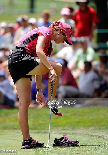 SPRINGS COPaula Creamer adjusts her sock on the 15th green during the second day of the US Women's Open at The Broadmoor Thursday morning Andy Cross...