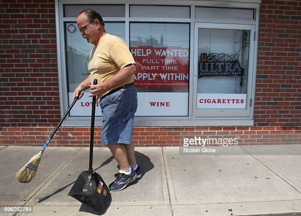 Copeland Package Store owner Dennis Carson sweeps up the sidewalk in front of his store in Quincy MA on Jun 13 2017 Employers struggle to find...