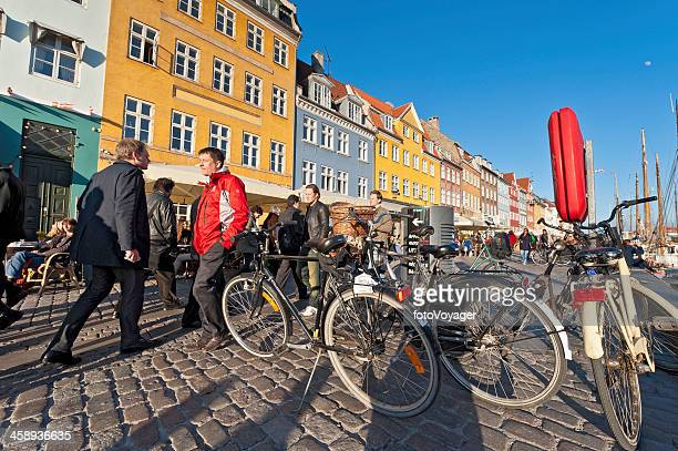 copenhagen bicycles and crowds on nyhavn - nyhavn stock pictures, royalty-free photos & images