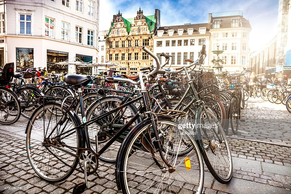 Copenhagen bycicle parked in a town square : Stock Photo
