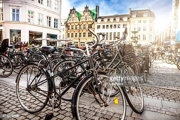 copenhagen bycicle parked in a town square - copenhagen stock pictures, royalty-free photos & images