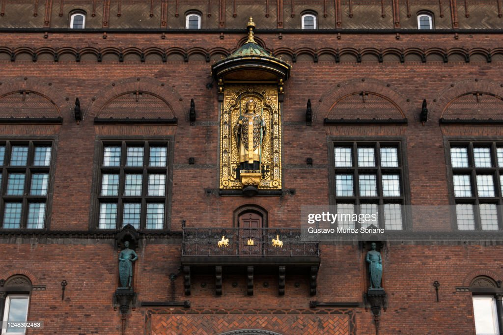 Copenhagen city hall facade with its richly ornamented front, of the gilded statue of Absalon a Danish statesman and prelate of the Catholic Church, famous person from Denmark : Stock Photo