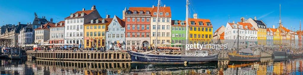 Copenhagen crowded Nyhavn colorful bars restaurants panorama beside harbour Denmark : Stock Photo
