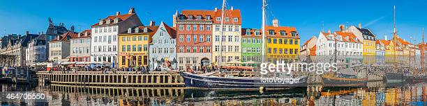 Copenhagen crowded Nyhavn colorful bars restaurants panorama beside harbour Denmark