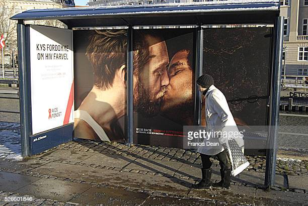 Copenhagen /Denmark 07 December 2013 _ Gay kiss billboard from Aids fond at public bus stop in front of christiansborg bus stop