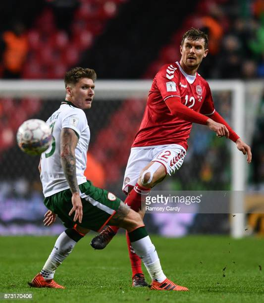Copenhagen Denmark 11 November 2017 Andreas Bjelland of Denmark in action against Jeff Hendrick of Republic of Ireland during the FIFA 2018 World Cup...